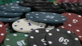 poker : Table With Poker Chips Turns In Casino.Poker Chips For Gambling Card Game.With a spin on the table Stock Footage