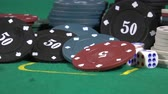 gaming chips : Poker player increasing his stakes throwing tokens onto the gaming table.