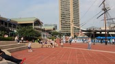 america : BALTIMORE - JUNE 12: People visit Inner Harbor on June 12, 2013 in Baltimore. Inner Harbor is a historic seaport and modern tourist attraction in Baltimore, the largest city in the state of Maryland.  Stock Footage