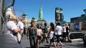 united states : LAS VEGAS, USA - APRIL 14, 2014: People visit the famous Strip in Las Vegas. 15 of 25 largest hotels in the world are located at the strip with more than 60 thousand rooms.