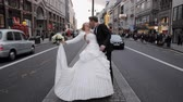 strand road : Just married couple kissing in the middle of Strand street, London