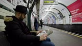 impatient : 4k Time Lapse with a still man waiting for the train, underground of London Stock Footage