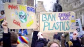 szyld : London, UK - October 12th, 2019 : Climate Change and Plastics Protest Signs, Hands holding up signs protesting climate change and calling for the ban of single use plastics in London, UK.