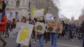 uithang bord : London, UK - October 12th, 2019 : Young Climate Change Protesters with Signs, Young people protesting climate change inaction in London, UK.