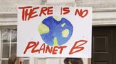 есть : London, UK - October 12th, 2019 : There is No Planet B Protest Sign, Close up of a sign reading There is no planet B at a protest in London, UK.