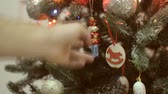 holding : Mans hand shakes Christmas toys on the Christmas tree. Stock Footage