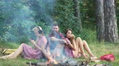 Friends camping eating food concept. Camp forest adventure travel remote relax concept. Young people having a camping Dostupné videozáznamy