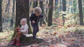 Happy little child, baby girl laughing and playing in the autumn on the nature walk outdoors.