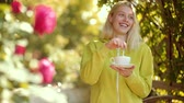tea time : Concept about morning coffee. Coffee give you energy for day. Beautiful happy smiling girl with blonde hair wearing autumn dress posing with coffee. Stock Footage