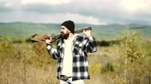 militar : Mountain hunting. Hunting is the practice of killing or trapping animals. Hunting in the woods.