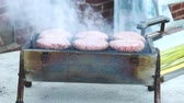 grelhado : Six Thick Hamburgers Cooking On Table Top Grill