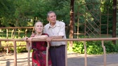 прочный : Man and a woman of eighty years standing leaning on the railing in the gazebo in the Park. Стоковые видеозаписи