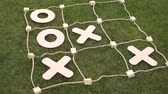 tık : Close-up large game TIC TAC toe in the Park on the grass. Stok Video