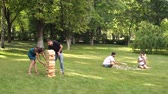 tık : Group of young people playing active games in the Park. Big game jenga and tic tac toe outdoor.