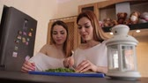 dill : Two sexy girls cook Breakfast at home in the kitchen, cut dill on a cutting Board. Stock Footage