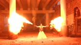 tehlikeli : A man with makeup skeleton Halloween holding two torches with a strong flame. Fire show. Halloween. Stok Video