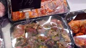 refrigerated : Close-up view of arranged raw meat in grocery shop. Pickled meat on the counter in the supermarket. Butchery with read meat on sale. Market store. Close-up of meat in a supermarket.