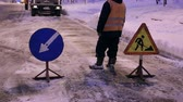 municipal services : Snowblower clear freezing winter road with snow and ice. Snow-plow remove snow from the city street. Warning road sign. Winter service vehicle snow blower work. Cleaning snowy frozen roads.