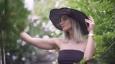 sikorka : Young stylish woman in hat does selfie. Female using a smart phone Wideo