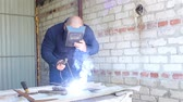 electrodes : Welder Working in the garage Stock Footage