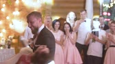 новобрачный : Young beautiful bride and groom dancing first dance at the wedding party. Wedding dance