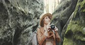 Portrait woman taking pictures with vintage camera. travel girl spring. beautiful attractive fun photography