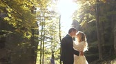 Wedding couple in autumn forest at sunset