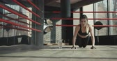 push ups : Fitness woman doing push ups on exercise mat. Healthy young female working out at studio Stock Footage