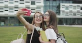 duas pessoas : Two beautiful carefree girls taking selfie with a smart phone. Women make funny faces. Best friends taking photos. Tourism,destination and friendship concept Stock Footage