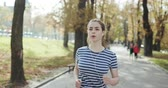 antreman : Young woman runner training in summer park. Close up fitness woman jogging outdoor. Tired girl jogger breathing after run marathon in park. Morning running concept