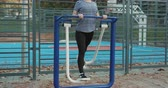 faaliyetler : Women are exercising outdoors with exercise machines. concept of losing weight with exercise for health