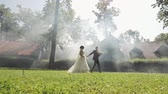 Lovely young caucasian bride and groom walking in the park. Wedding couple. Happy family. Newlyweds. Man and woman in love.