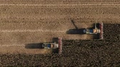 Self driving Autopilot technologies. Two Electric Combine, Harvester Removes Oats, view from Height