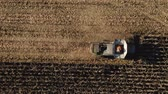 produtividade : Combine Harvester Machine Harvesting Corn Field in Autumn. Self driving Autopilot technologies. Electric Combine, Harvester Removes Oats, view from Height.