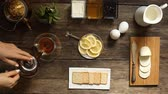close up : lemon tea and fruit candy on wooden table. Stock Footage