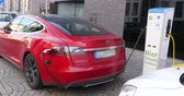 tesla motors : Tesla electric car charges at a charging station Stock Footage