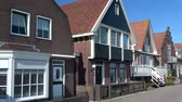 idade : Volendam is a small village in the district of North Holland, Netherlands.