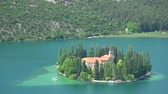 maj : The Visovac Monastery is a Catholic monastery on the island of Visovac in the Krka National Park, Croatia.