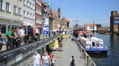 пешеходный мост : Old town of Gdansk with the Old Harbor - Poland. Стоковые видеозаписи