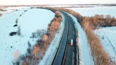 Winter sunset road. Passing cars, trucks. Aerial view landscape.