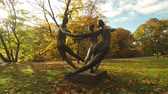 bastião : Riga Latvia - october 25 2017: Sculpture of three dancing women (Dance World circa 1970s) in Bastion Hill (Bastejkalns) park of Riga Latvia. Work of sculptor Parsla Zalkalns
