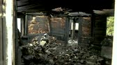 weathered : Burned House Interior After Fire, Ruined Building Room Inside, Disaster or War Aftermath Concept. Black Coal Texture of the Scorched Wooden Boards and Window of the House Walls. Stock Footage