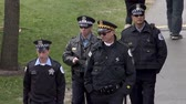 лига : Chicago - April 30, 2015 NFL Draft The Police Sheriff Officiers in the Draft Town in Grant Park Milenium park. Стоковые видеозаписи