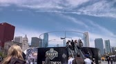 chicago : Chicago - April 30, 2015 NFL Draft. Skydiving Simulator Wind Tunnel at the Draft Town.The Attraction Is Called the Sweetness Simulator NFL Fans Fly Against the Backdrop of the Chicago Skyline.