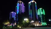 reconstrução : GROZNY, RUSSIA - JUNY 24, 2018: Skyscrapers in  Neon Light Grozny Chechnya at the Night. Buildings in the District of Grozny City Chechnya Heart