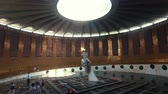 honra : Volgograd, Russia - JUNE 24,2018. eternal flame in a Hall of Military Glory on Mamayev Kurgan Visitors and Tourists of the Memorial Complex on the Anniversary of Victory in Great World War II.