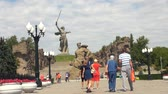 soldado : Motherland Statue in Mamaev Kurgan. Stalingrad  Volgograd. Visitors and Tourists of the Memorial Complex on the Anniversary of Victory in Great World War II. Vídeos