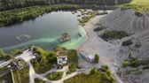 Aerial landscape Sand Hills of Quarry With a Pond and Abandoned Prison in Rummu Estonia Europe. Flooded Houses of Former Prison. Mountain in the Abandoned Mines Sunken Ruins of Soviet Time Prison Wideo