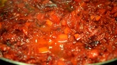 borscht : Finely chopped beets and carrots fried in a frying pan in oil. Vegetables for borsch.
