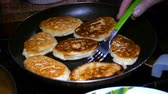 mesa de madeira : Homemade baking. Cooking fried pancakes Pancakes Stock Footage